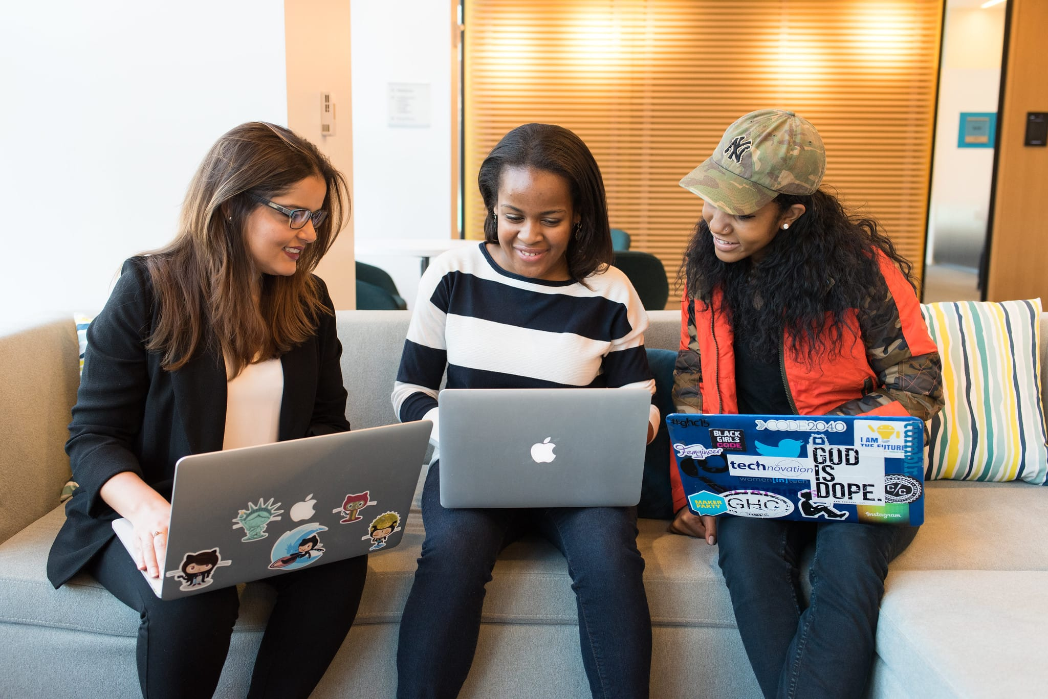 Group of women looking at a laptop